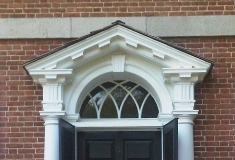 Georgian houses displayed a strict symmetry with a paneled door as a centerpiece capped by an elaborate crown or pediment.