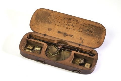 Coin Scale box containing a scale and weights