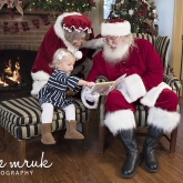 Grace with Santa and Mrs. Claus