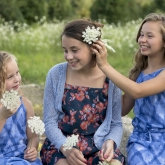 three girls with the Queen Anne's Lace flowers