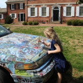 little girl painting David's car