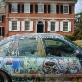 David's paint covered car in front of the Corbit Sharp House